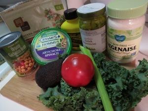 Ingredients: Beyond Meat Chicken, garbanzo beans, hummus, mustard, vegenaise, pepperoncinis, avocado, tomato, celery, and kale.